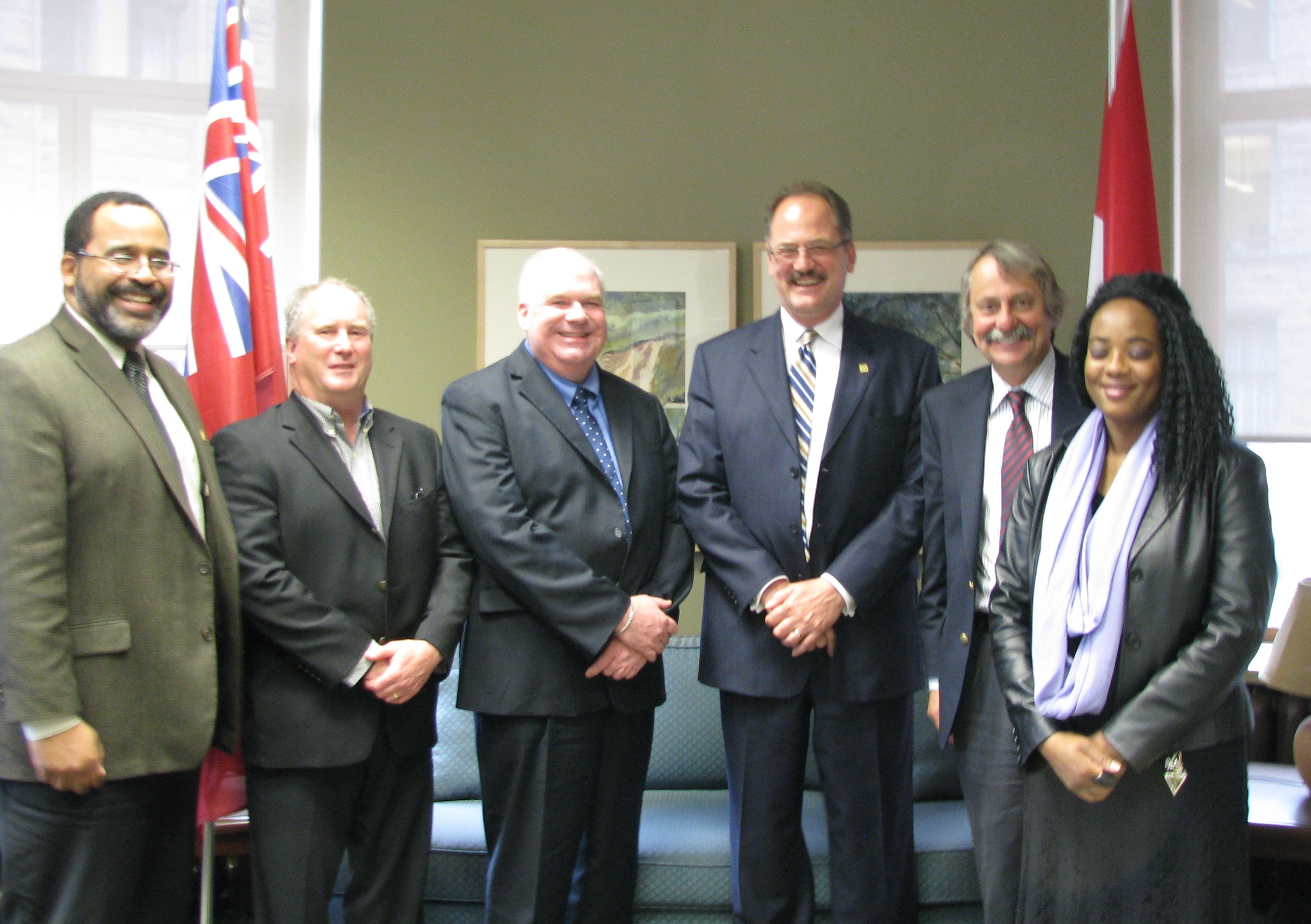 (L-R) Al Jones PAC, Richard Borland, MPP Jim Wilson, Advocis Simcoe-Muskoka Chapter President Raymond Matt, Gary Laakso and Advocacy Chair Erika Conyette pose for a picture during their visit to Queen's Park on April 29, 2014.